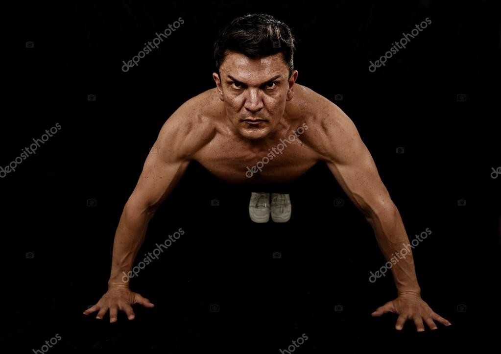 Strong fit sport man doing push up workout training on gym