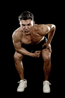 strong fit man with ripped body doing squat exercises showing defined shoulders and biceps