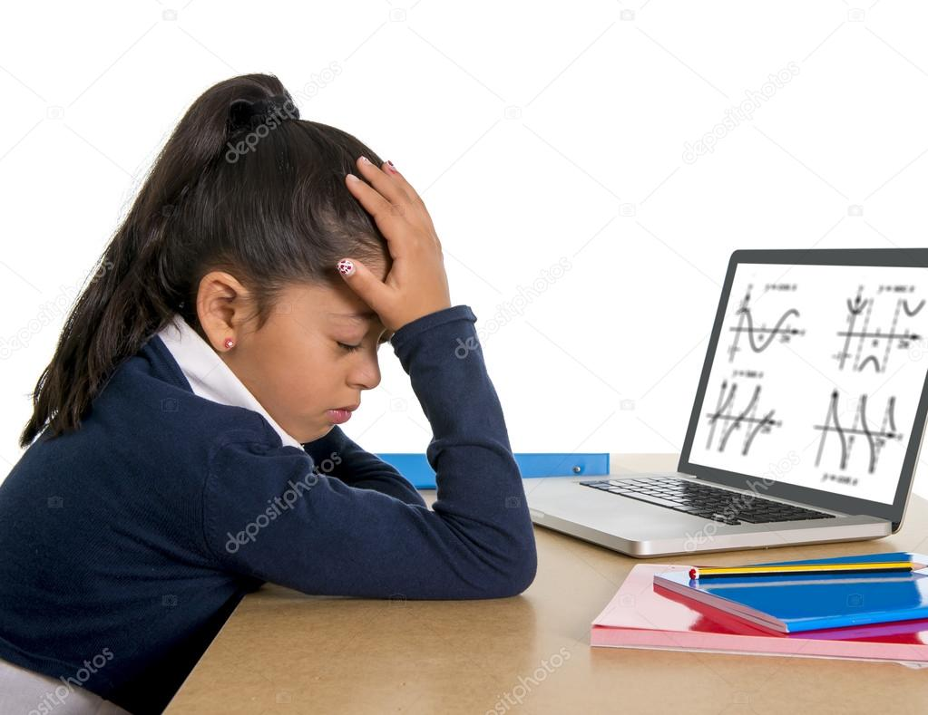 spanish little schoolgirl bored and tired with computer maths