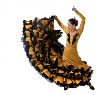 Young Spanish woman dancing flamenco in typical folk tailed gown dress