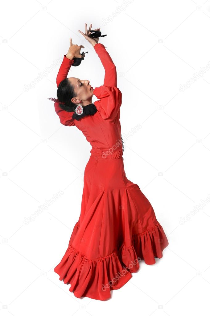 01d62961d7ce Young Spanish woman dancing Sevillanas with castanets in hands wearing  typical folk red dress in flamenco traditional dance of Spain concept  isolated on ...