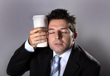 sleepy addict businessman holding take away coffee in caffeine addiction