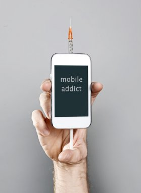 internet cellphone addict man holding mobile phone with syringe in addiction concept