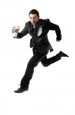 young attractive businessman with take away coffee running late to work  in stress
