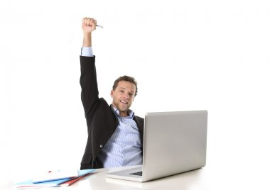 Young attractive businessman happy and hectic at office work sitting at computer desk satisfied celebrating