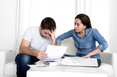 young couple worried at home in stress accounting bank payments