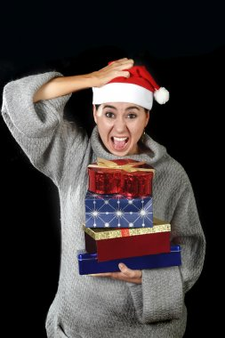 funny desperate woman in Santa Christmas hat in stress about December gifts and presents shopping screaming