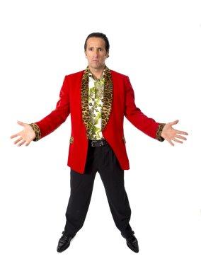 Funny rake playboy and bon vivant mature man wearing red casino jacket and Hawaiian shirt standing happy posing gigolo alike