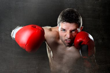 aggressive boxer man boxing in fighting gloves throwing angry right hook punch