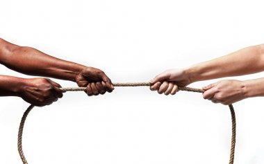 Black ethnicity arms with hands pulling rope against white Caucasian race person in stop racism and xenophobia concept