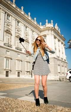 young beautiful tourist girl visiting Europe in holidays exchange students and taking selfie picture