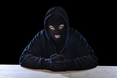 criminal or terrorist man in mask hidden identity in secret illegal activity crime concept