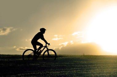 profile silhouette sport man riding cross country mountain bike