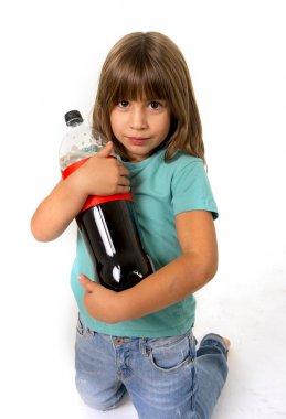 little female child holding big cola soda bottle looking vulnerable in children sugar addiction