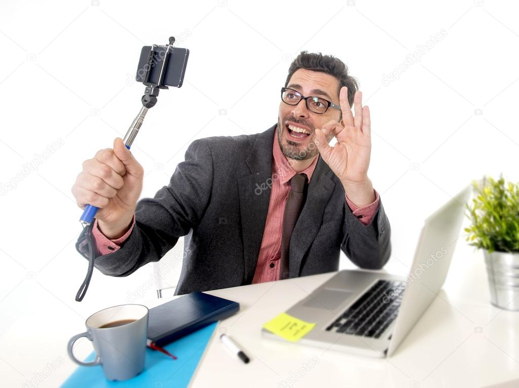 Funny Nerd Businessman At Office Desk Taking Selfie Photo With