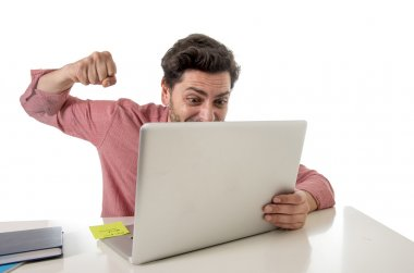 businessman at office working stressed on computer laptop overworked throwing punch in work stress