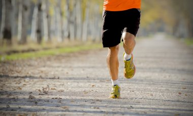 sport man running outdoors in off road trail ground in fitness and healthy lifestyle concept