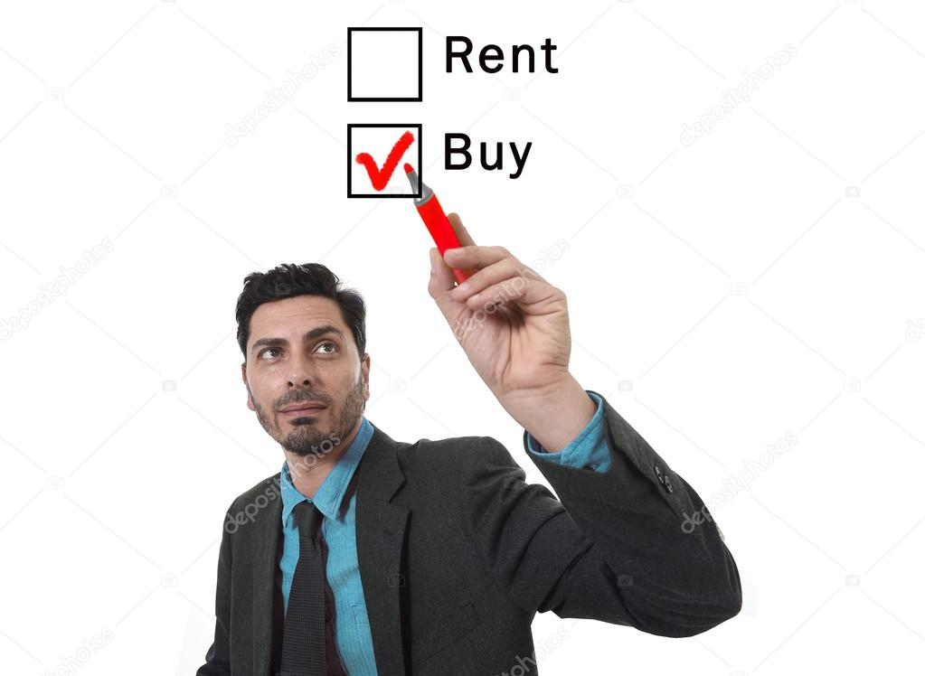 Attractive Hispanic businessman choosing rent or buy option at ...