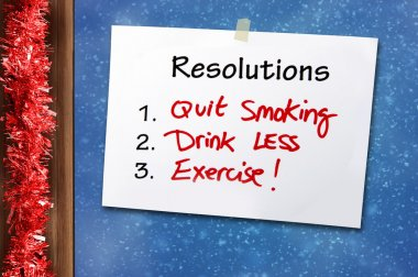 New year Resolutions Handwritten Note for a Healthy Life with quit smoking drink less and doing exercise