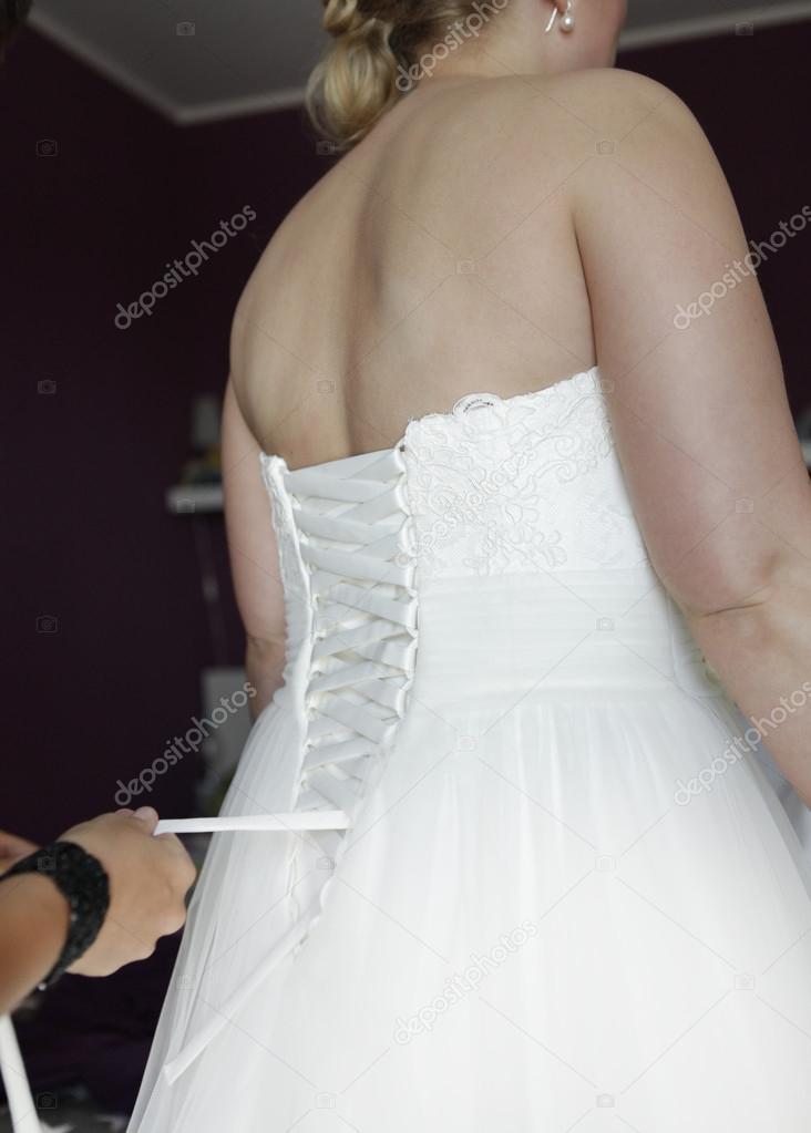 geschnürt Hochzeitskleid — Stockfoto © Purple_Queue #53250131