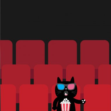 Cat sitting in movie theater eating popcorn.