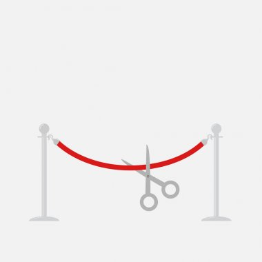 Scissors cutting red rope