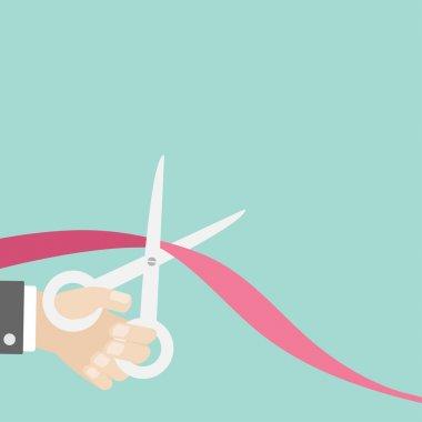 Hand with scissors cut ribbon