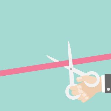 Hand scissors cut the straight ribbon