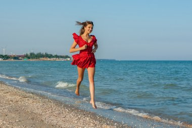 Young woman runs on the sea