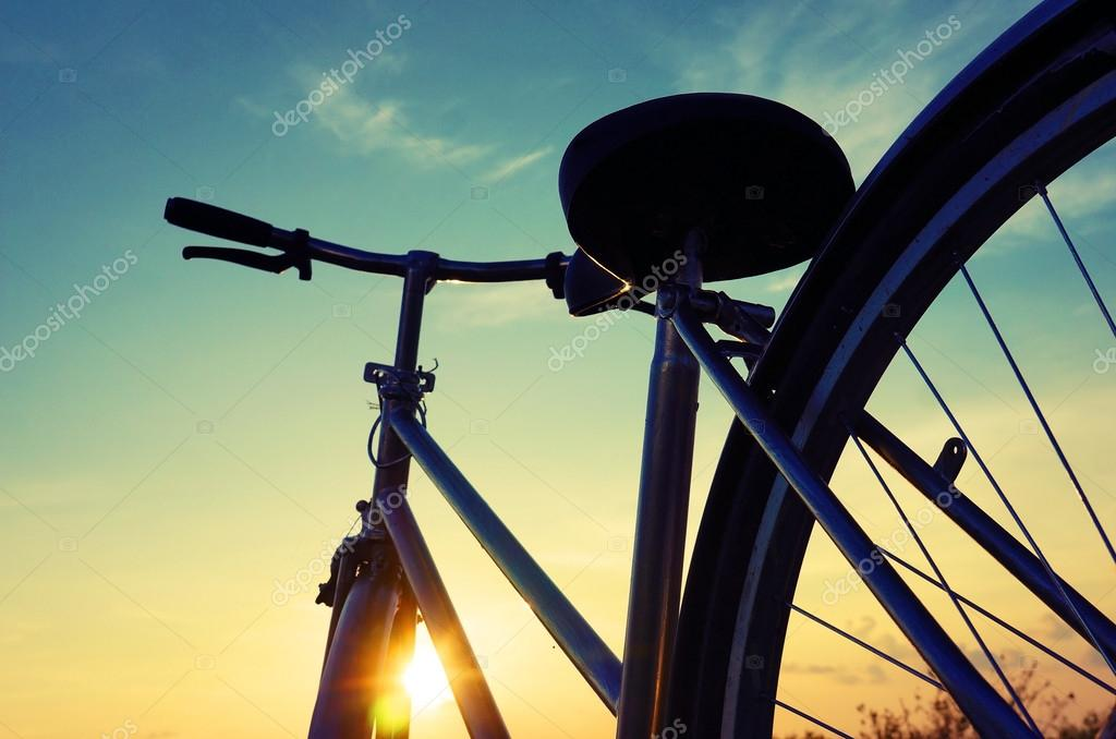Beautiful bike silhouette, sunset, Vietnam countryside