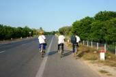 Asiatische Schüler Fahrt Fahrrad