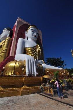 Unknown tourist visits  Kyaik Pun Pagoda in Bago,Myanmar.