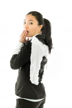 Asian young businesswoman dressed up as white angel covering her mouth by her hands and looking shocked isolated on white background