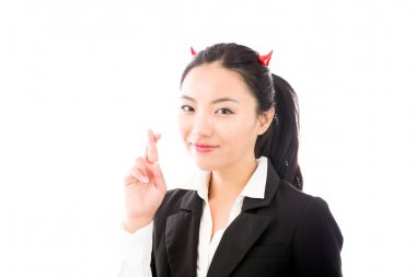 Devil side of a young Asian businesswoman standing with her fingers crossed isolated on white background