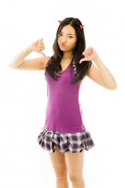 Asian young woman dressed up as a devil  and showing thumbs down sign from both hands isolated on white background