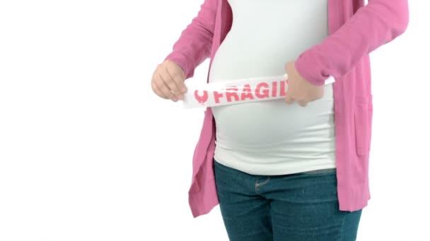 Těhotná žena s křehkou znamení