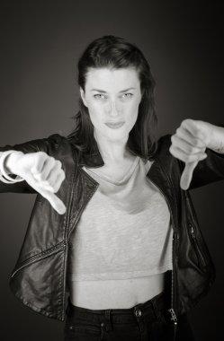 Model gesturing thumbs down