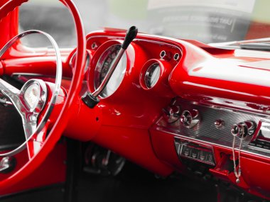 Red steering wheel of a classic car