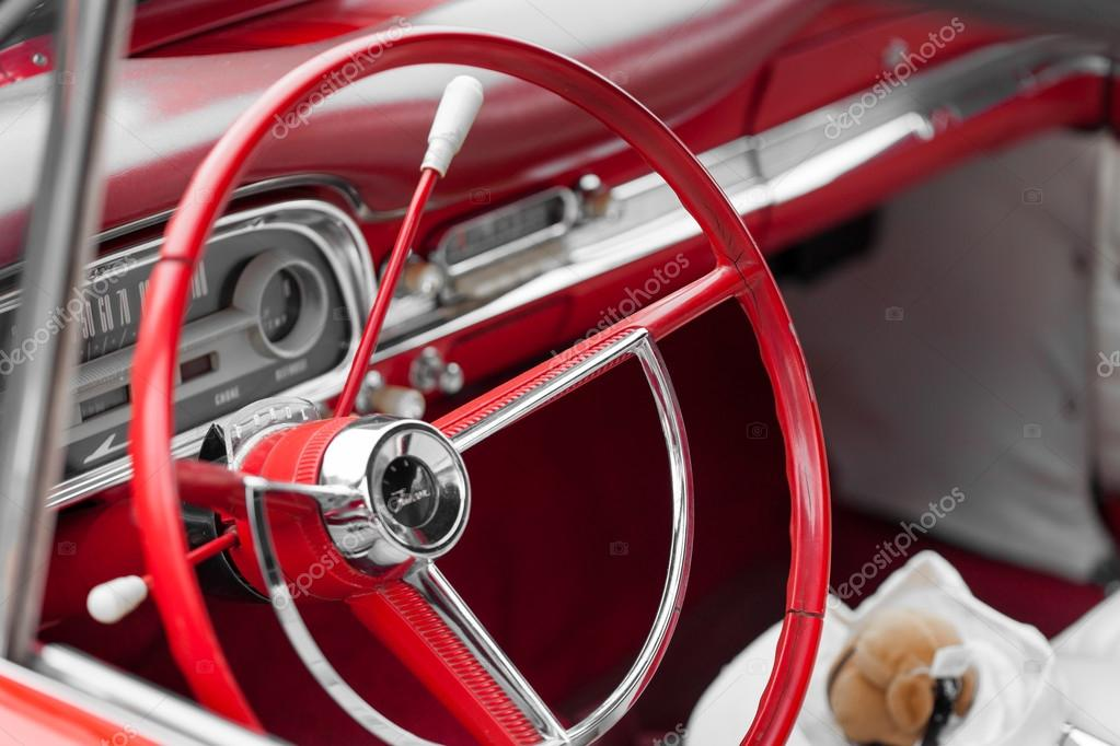 Red steering wheel of a vintage car — Stock Photo © Bruno135 #96082846