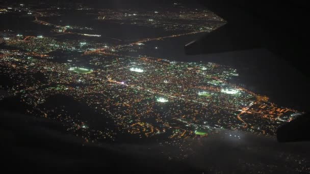 illuminated city seen through airplane  at night