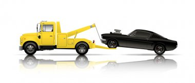 tow truck towing black muscle car