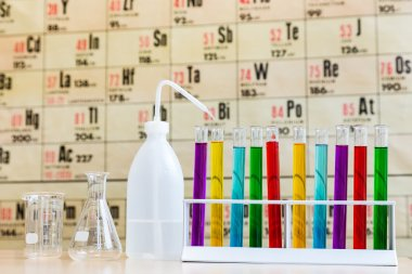 Chemistry with colored test tubes and glass