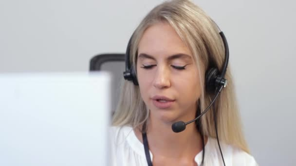 Young Woman Working in Call Center Talking to Customer With Headset. Stati
