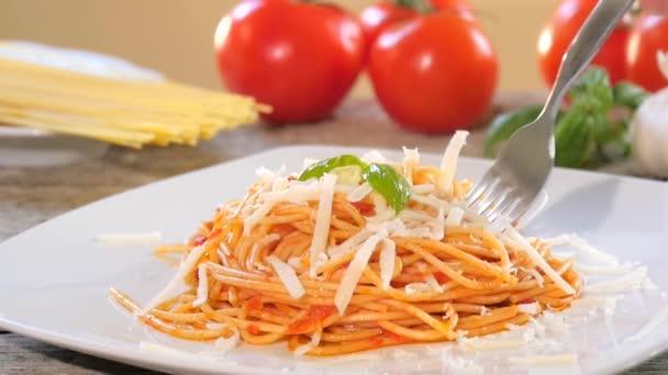 Eating italian spaghetti with tomato sauce