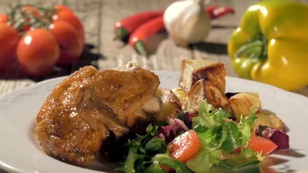 Roast chicken with baked potatoes and salad