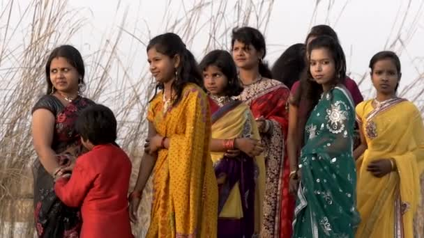 Indian young people near the Ganges river in the vicinity of Varanasi city, march 2015