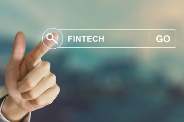 business hand clicking fintech or financial technology