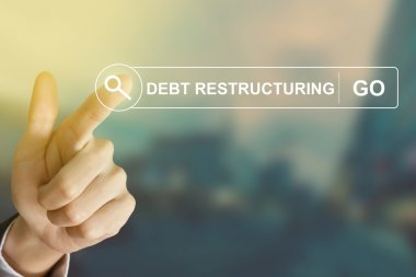 business hand clicking debt restructuring button