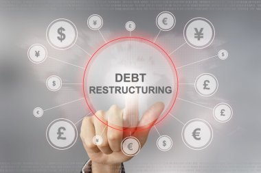 business hand pushing debt restructuring button