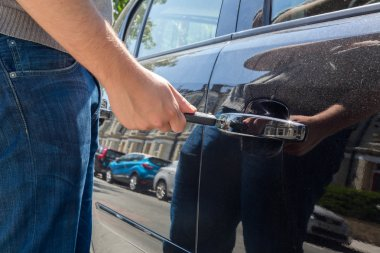 Man locking or unlocking a car door